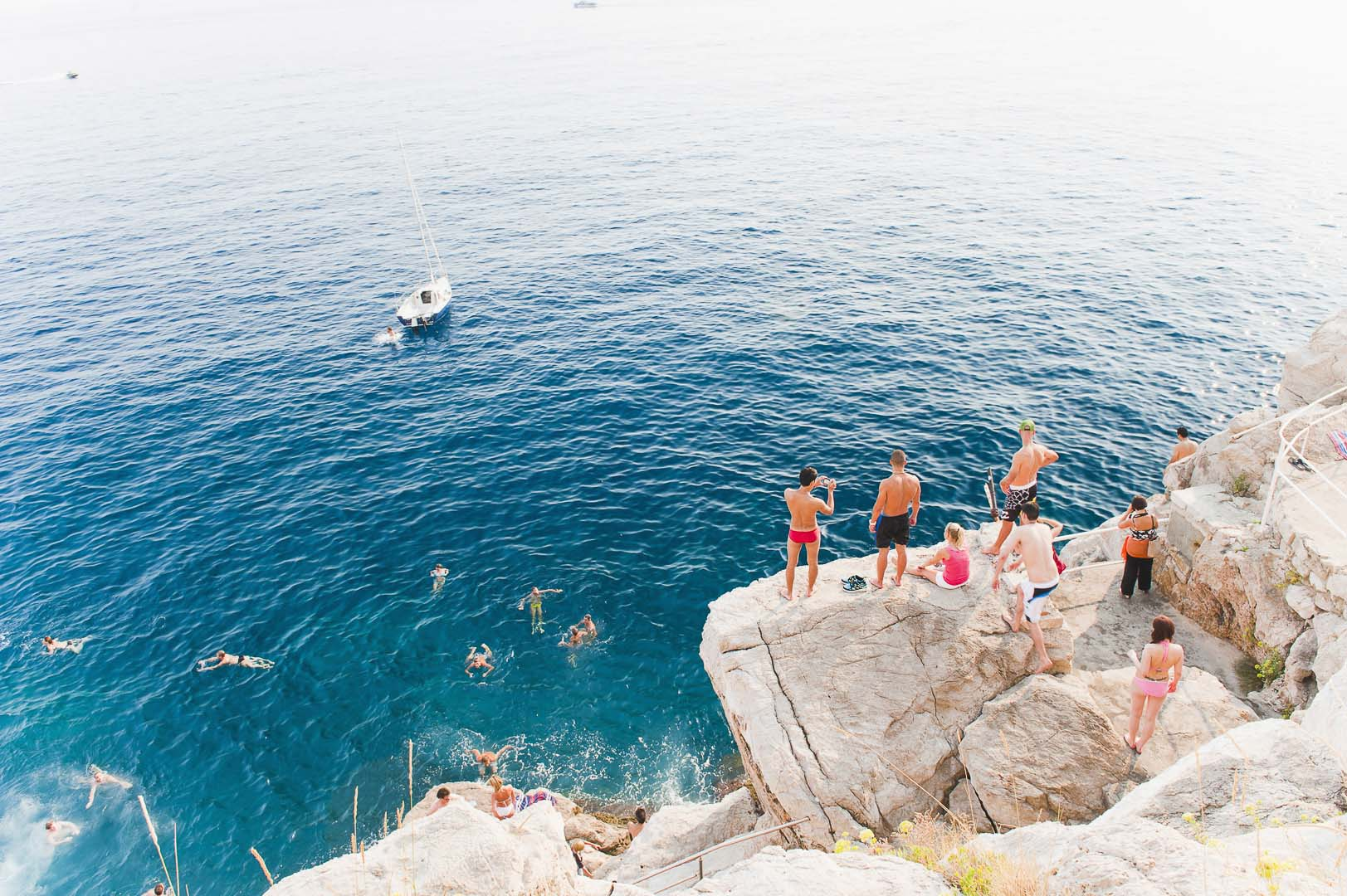 Dubrovnik, Croatia, Buza Bar, aka Cafe Buza, swimming off rocks, lifestyle travel photography by travel photographer Matthew Williams-Ellis